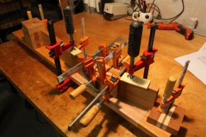 The scarf joint on the neck is glued using many clamps on a neck jig that I built.