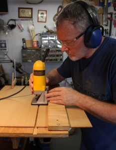 Using the trim router and routing jig to prepare for the top join.