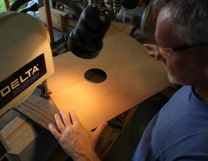 Carefully cutting out the outline of the top.Close-up of the cutting out process.