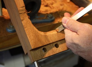 Reversing the chisel on the upstroke to cut to the contour of the heel.