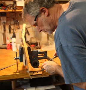 With the neck clamped firmly in my bench vise, I carefully chisel to the facet lines.