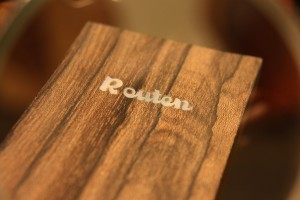 The Mother-of-Pearl Routen logo inlayed and sanded.