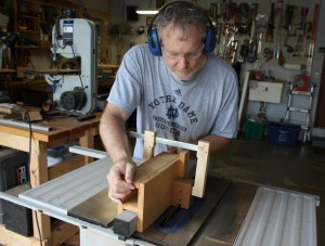 Using the Delta table saw to hollow out the mortise for the neck tenon