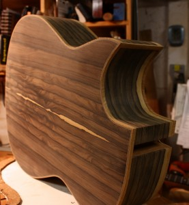 The back and cutaway after the first sanding. The Mahogany binding really compliments the Ziricote.