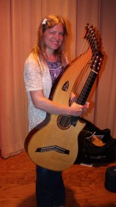 Muriel and her harp guitar built by Mike Doolin.