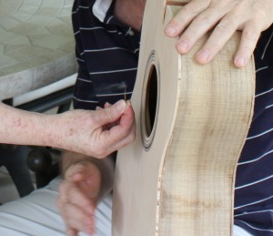 The match test. When the body is complete, a match is held in front of the soundhole. A responsive top will blow out the match with a couple of taps on the top. It blew out on the first tap!