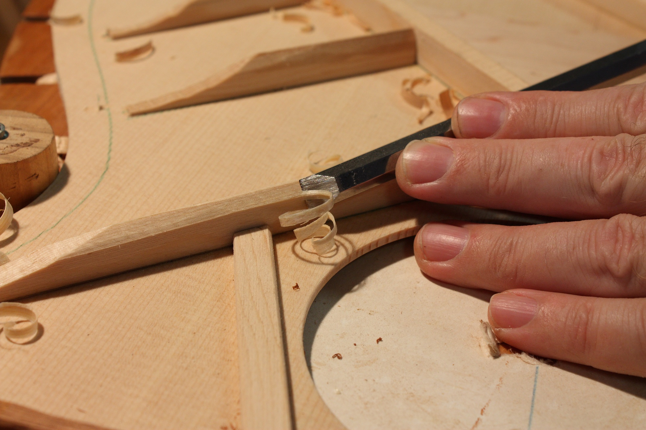 Shaping the Spruce braces of the top. I shaved and scalloped the braces until a clear tap tone was achieved.