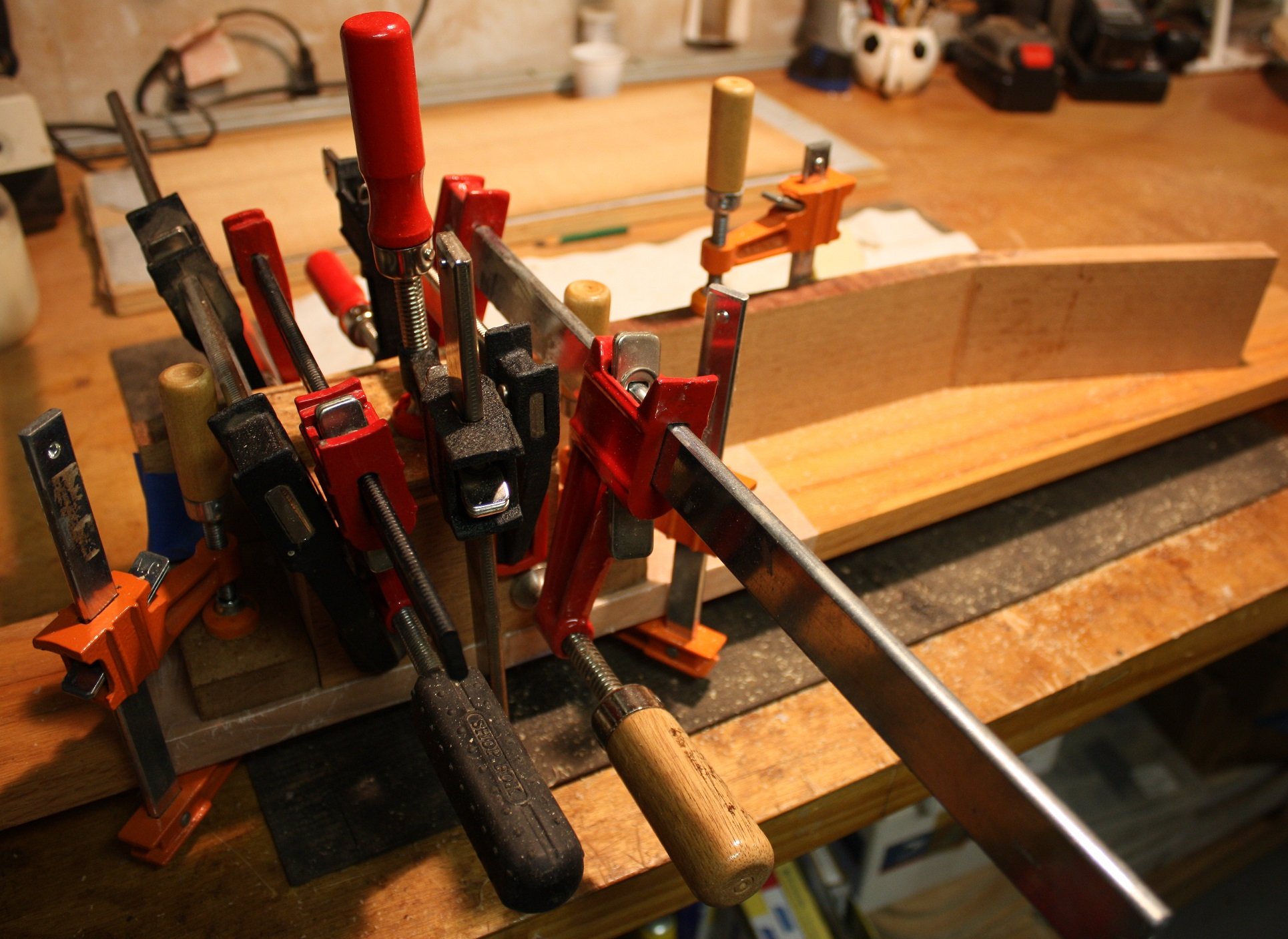 Clamping the stacked heel of the neck.