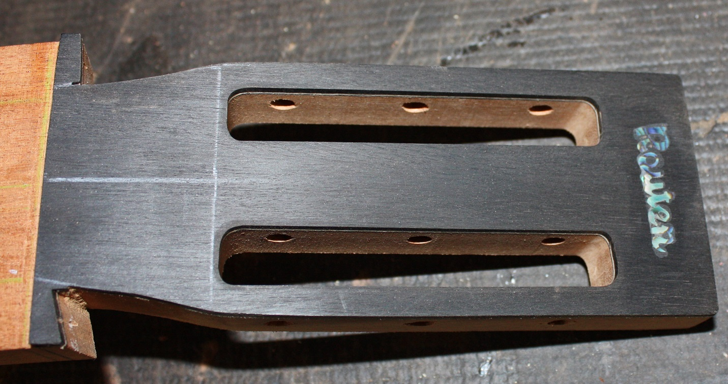 The headstock with the Routen logo and slot head sections.
