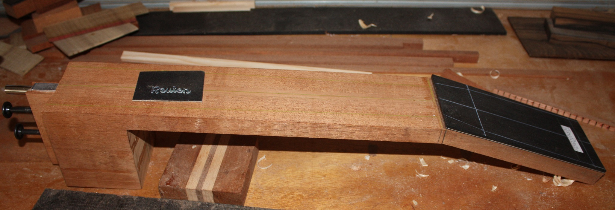 Inlaying the Routen logo in the headstock.