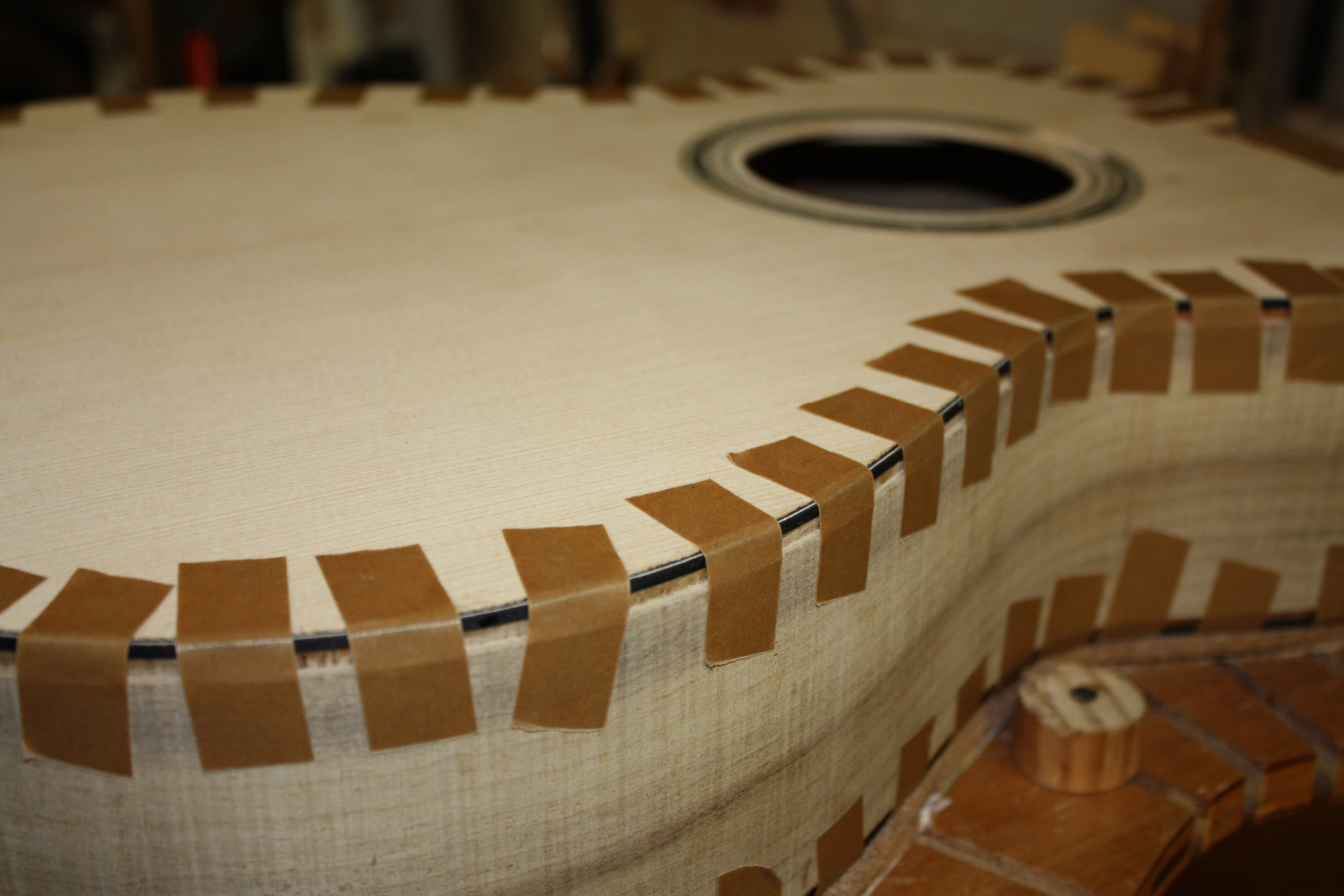 Binding tape holding the purfling in place.