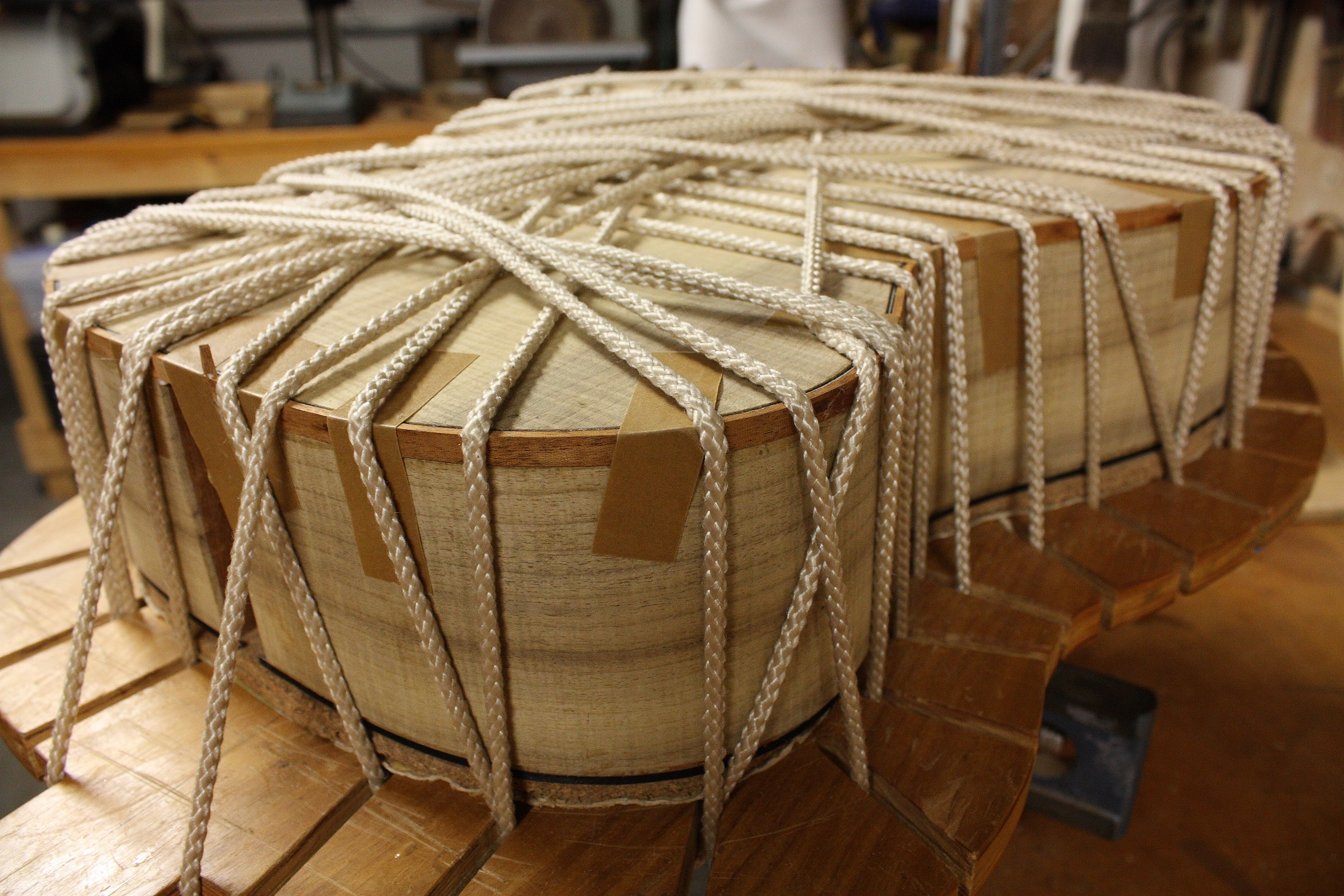 Rope is used to hold the binding in the body channel during the glue up stage.