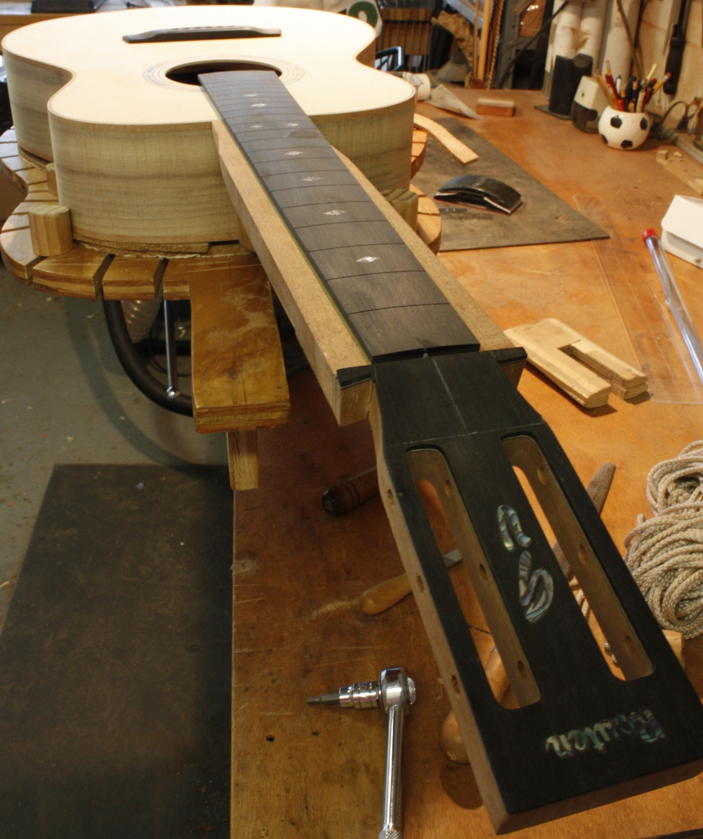 The neck is temporarily attached to the body to measure the angle. It is not totally shaped yet.